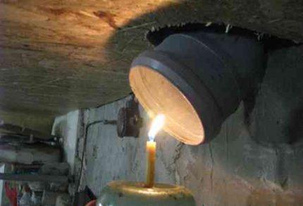 Просушка погреба свечой